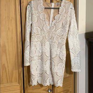 White 3/4 sleeve deep V dress